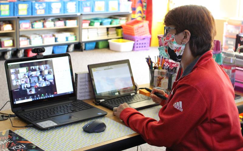 A Harmony Hill teacher teaching a virtual lesson