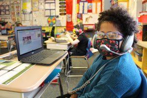 Van Schaick student watches Career Week presentation.